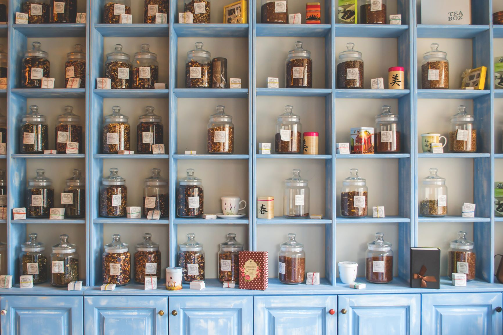 assorted-jars-on-blue-shelf-cabinets-165228